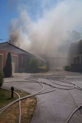 Burning unit - Driveway with hoses